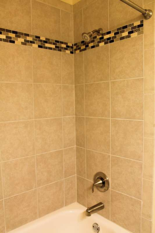 Highlands.st.francis.apartment.renovated.master.bath.tile